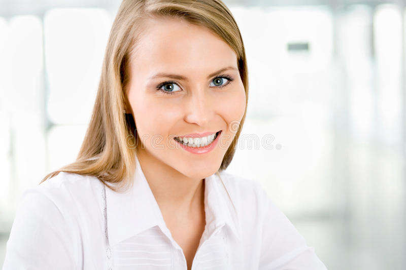 Young business woman smiling royalty free stock photography