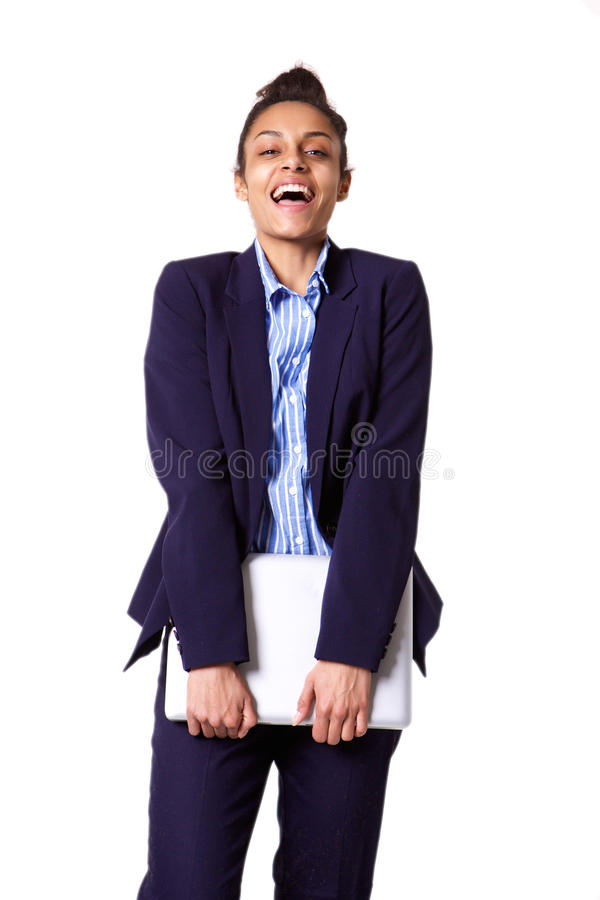 Young business woman smiling and holding laptop. Portrait of young business woman smiling and holding laptop against white background royalty free stock images