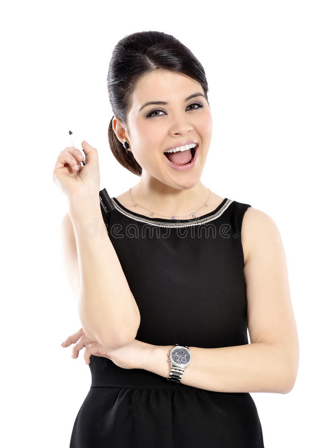 Young business woman smiling holding a pen stock photo