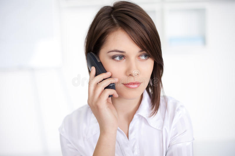 Download Young Business Woman Speaking On Phone Call Stock Photography - Image: 25750882