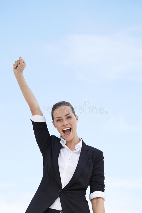 Free Young Business Woman Standing Against Blue Sky, With One Arm In The Air Stock Photo - 40010300