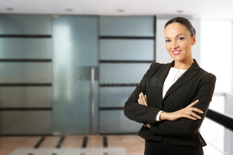 Young business woman, standing in front of the office. Young business woman standing in front of the office royalty free stock images