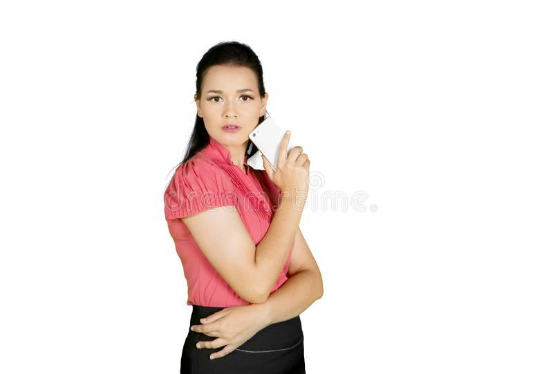 Business woman standing in studio with smartphone royalty free stock image