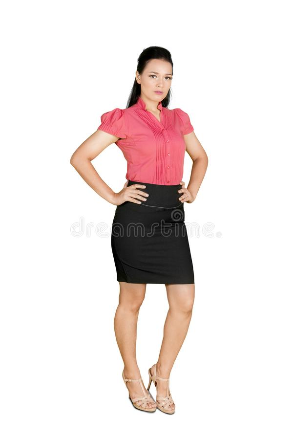 Business woman standing and looks confident stock photo