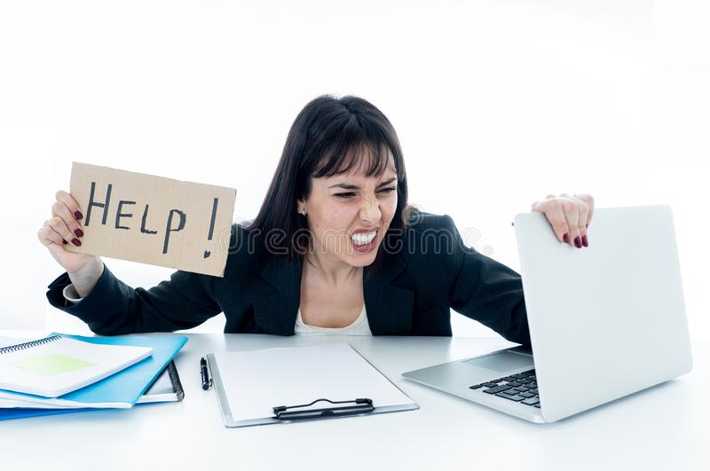 Young business woman stressed and desperate with laptop. frustrated stock photography