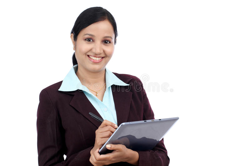 Young business woman with tablet and stylus. Young Indian business woman with tablet and stylus against white background stock image