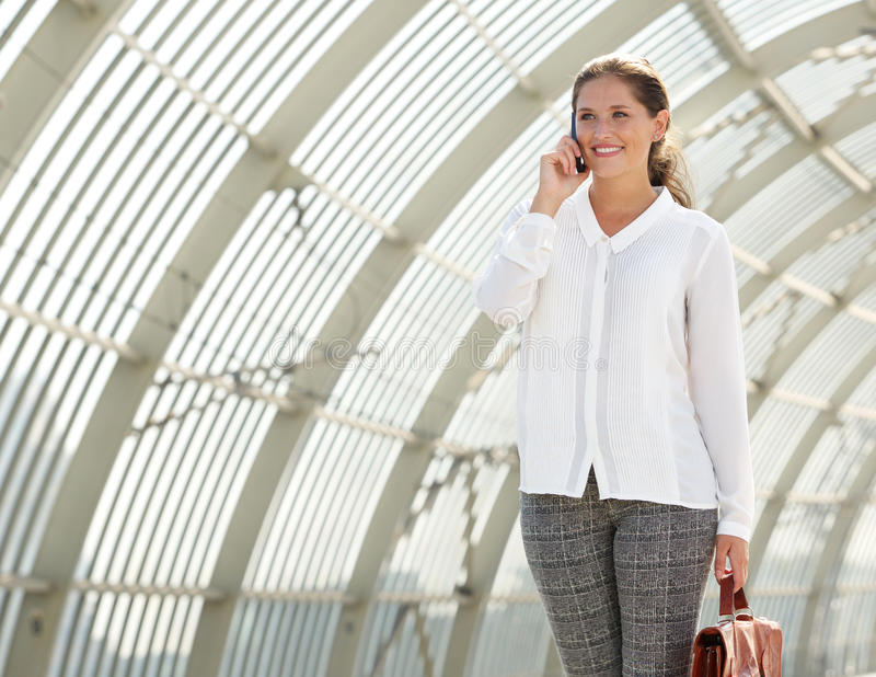 Young business woman talking on mobile phone royalty free stock image