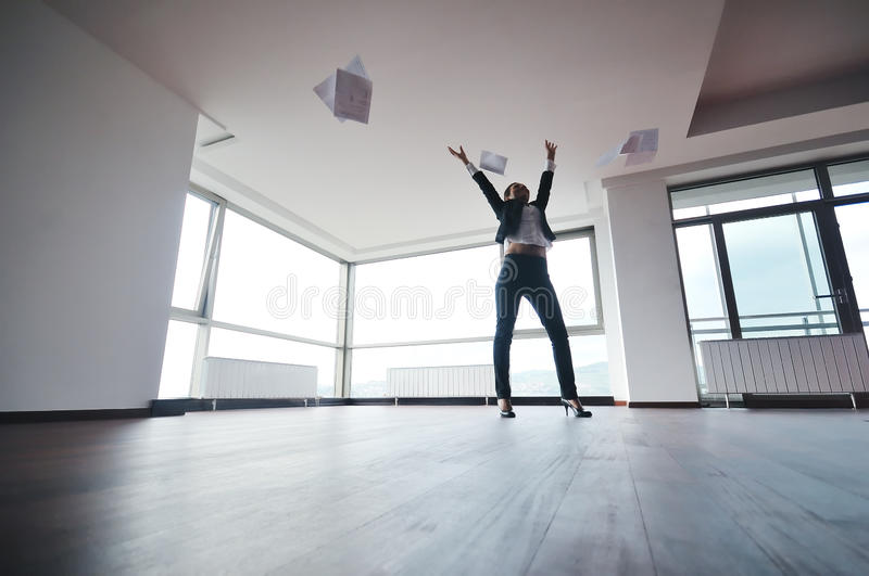 Young business woman throw papers in air stock photo
