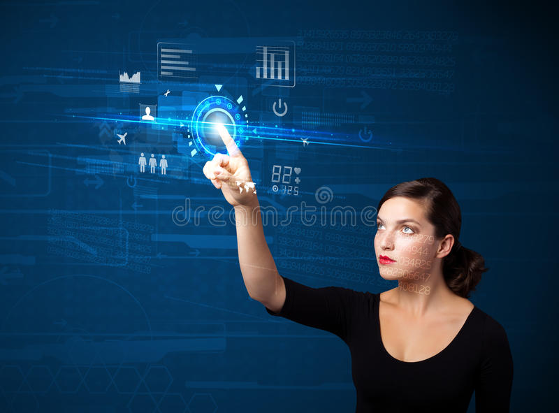 Young business woman touching future web technology buttons and. Business woman touching future web technology buttons and icons royalty free stock photography