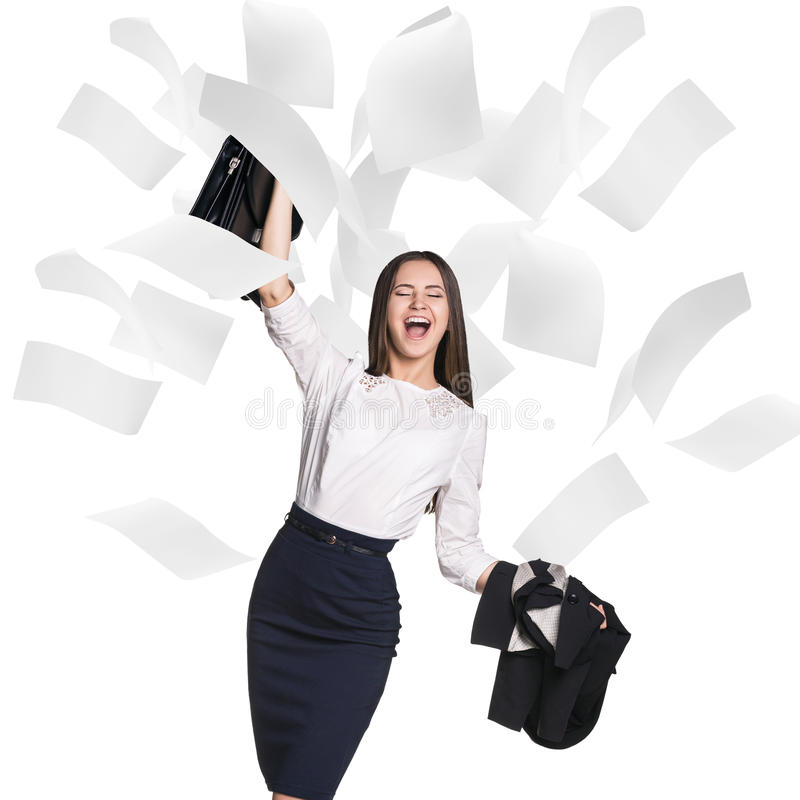 Young business woman under falling pages. stock image