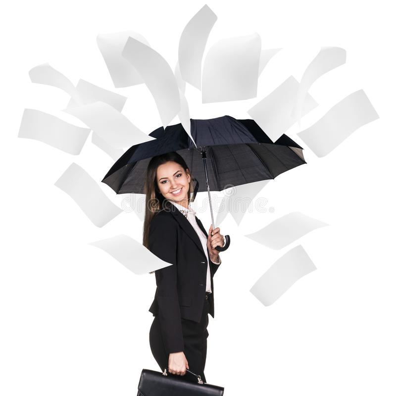 Young business woman under falling pages. royalty free stock photography