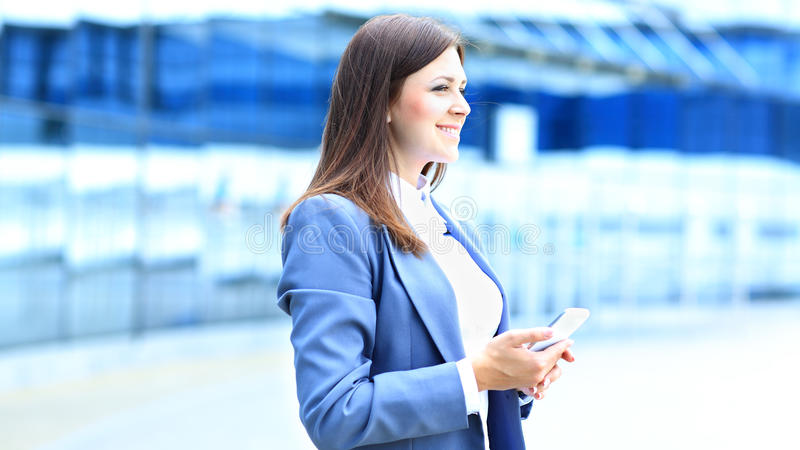 Download Young Business Woman Using Mobile Phone Stock Photo - Image: 33488168