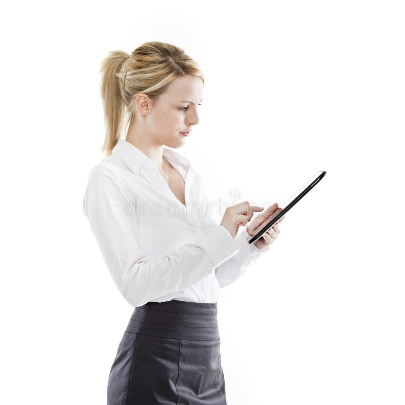 Young business woman using a tablet computer royalty free stock image
