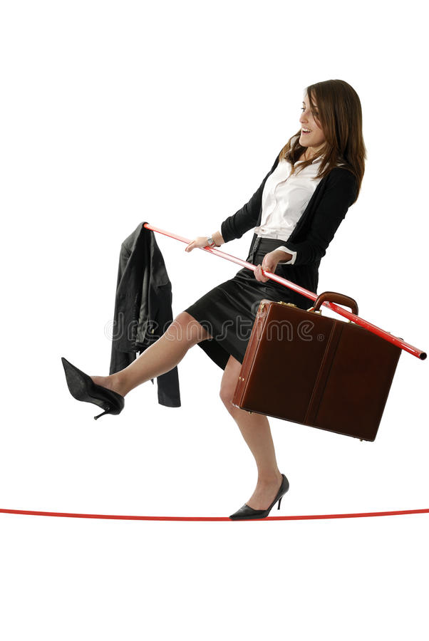 Download Young Business Woman Walking On A Tightrope Royalty Free Stock Photos - Image: 13345878