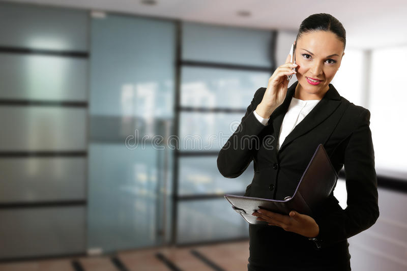 Young business woman, working in front of the office. Young business woman working in front of the office stock photo