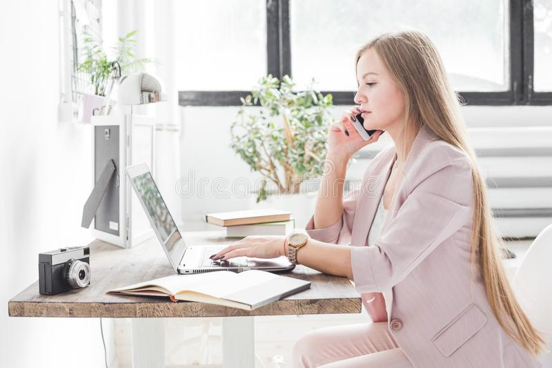 Young business woman working at home. Creative Scandinavian style workspace.  royalty free stock images