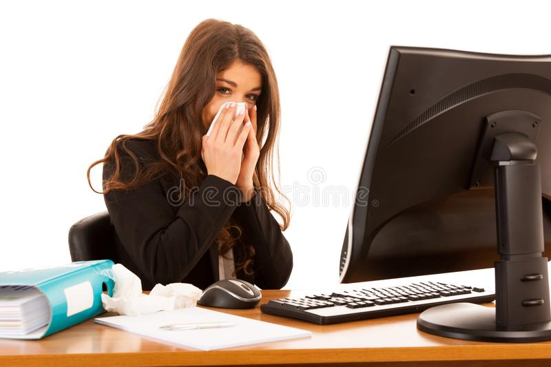 Young business woman working ill in office suffering - ilness a royalty free stock images