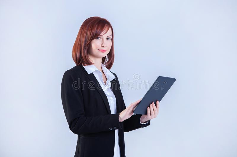 Young business woman working on laptop. Attractive mature businesswoman working on laptop stock image