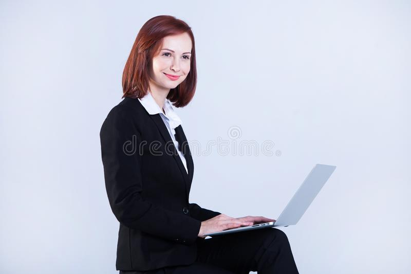 Young business woman working on laptop. Attractive mature businesswoman working on laptop royalty free stock photo