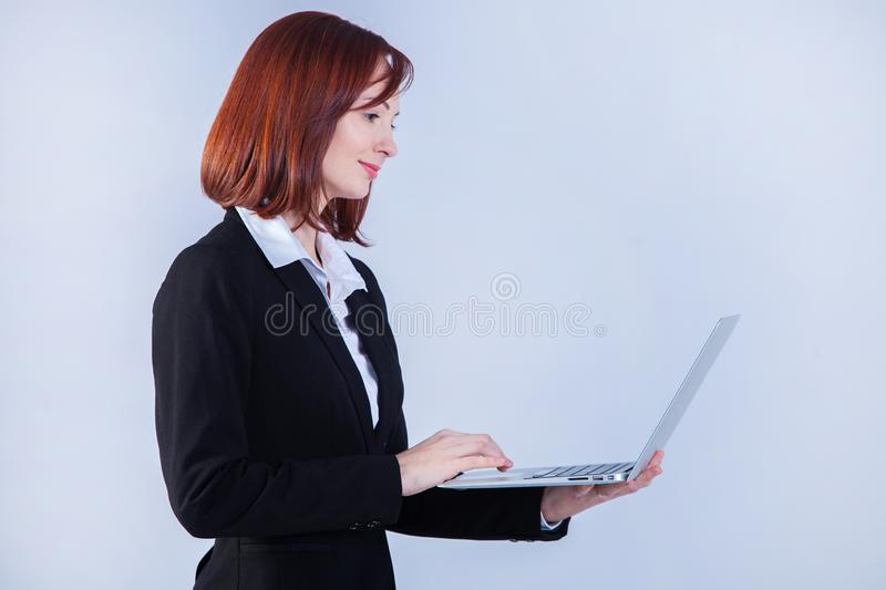 Young business woman working on laptop. Attractive mature businesswoman working on laptop stock photos
