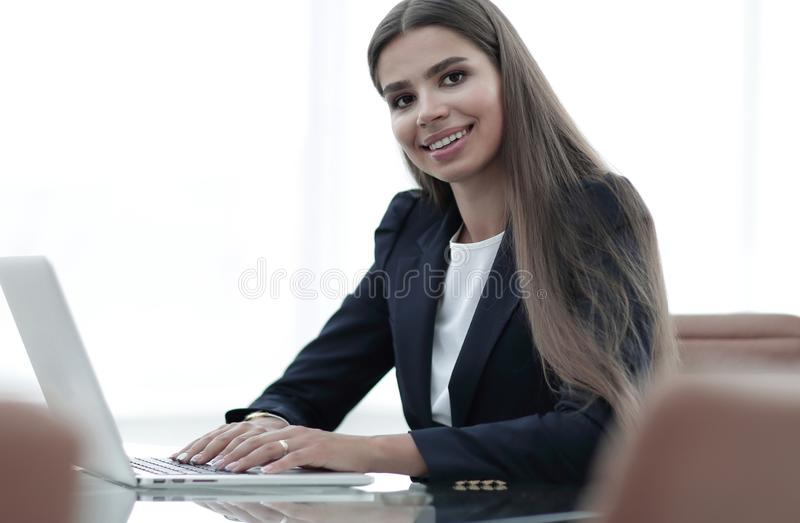 Young business woman working on laptop stock photo