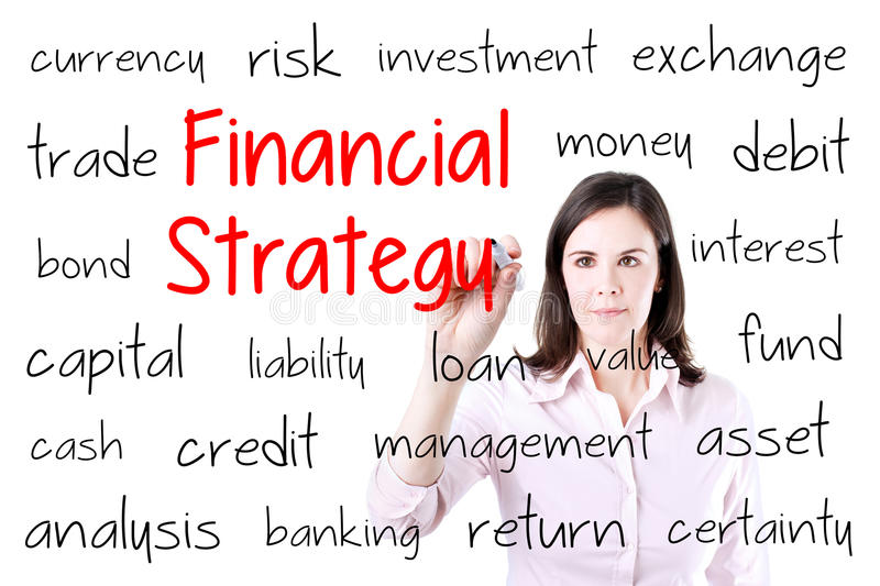 Young business woman writing financial strategy concept. Isolated on white. Young business woman writing financial strategy concept. Isolated on white royalty free stock photography