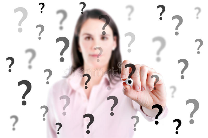 Young business woman writing question mark. stock photos