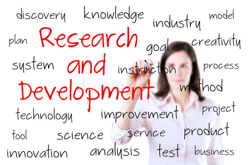 Young business woman writing research and development concept. Isolated on white. stock photo