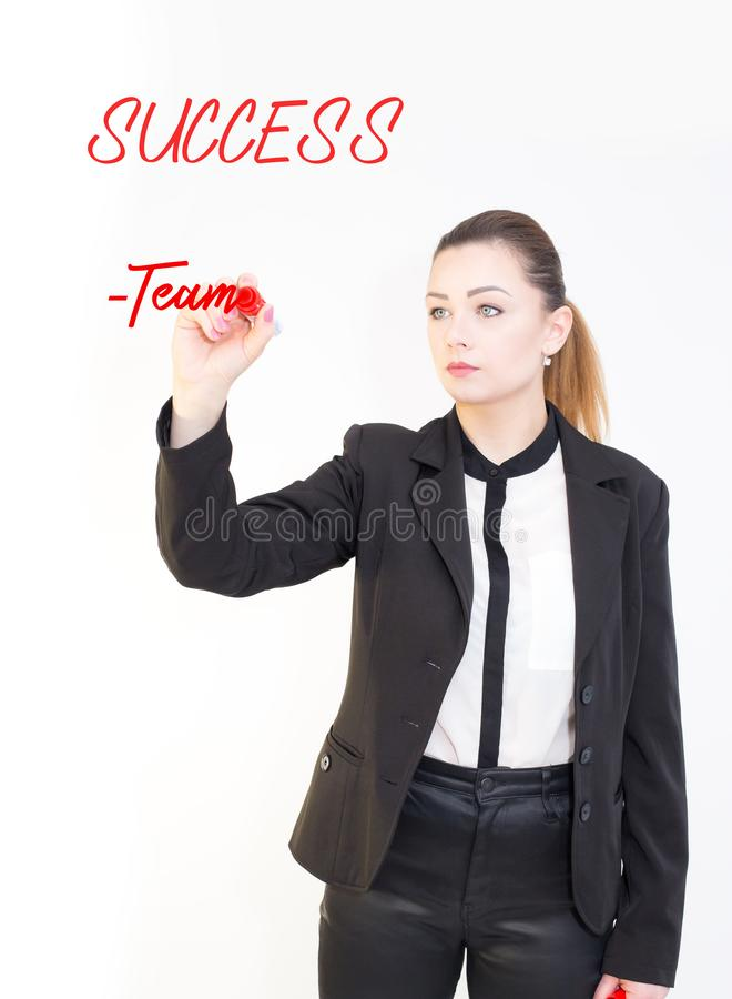 Young business woman writing success diagram on glass board with marker, white background . stock image