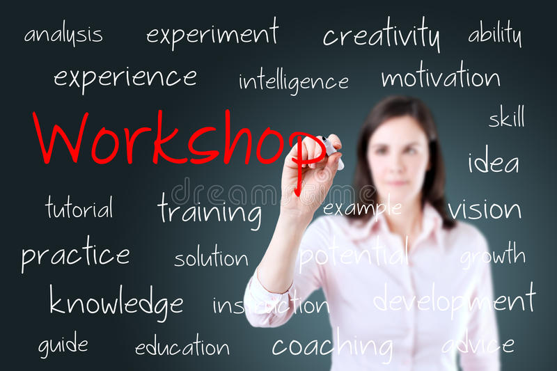 Young business woman writing workshop concept.  royalty free stock photo
