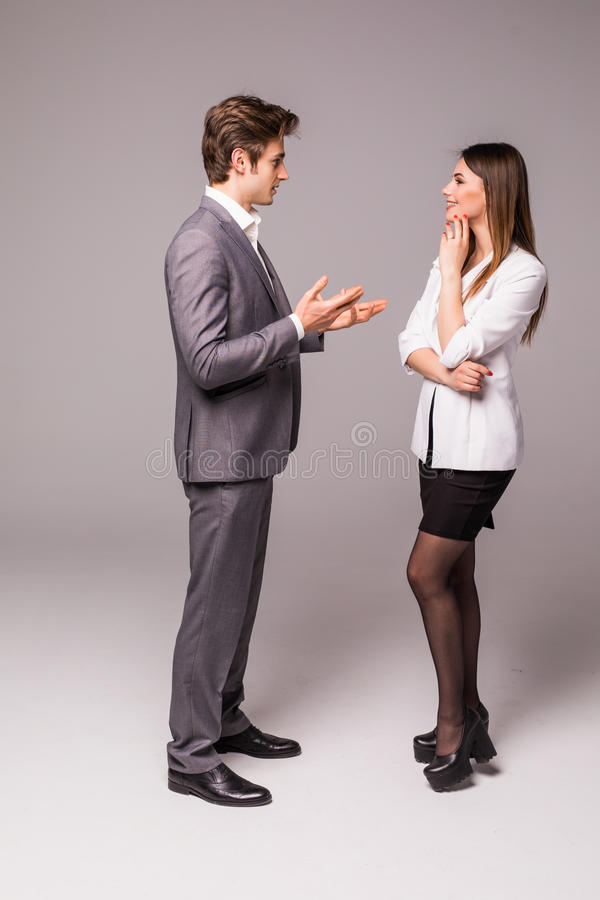 Young smiling business woman and business man isolated on grey background royalty free stock photos