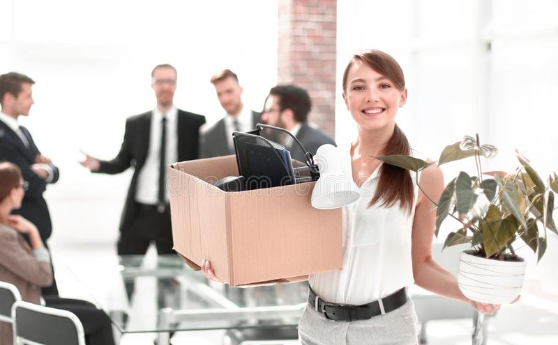Young business woman with personal things on office background stock photo