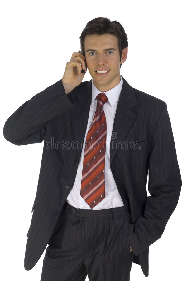Young businessman. Smiling, handsome businessman. Talking by mobile phone. Looking at camera. Isolated on white in studio royalty free stock photo