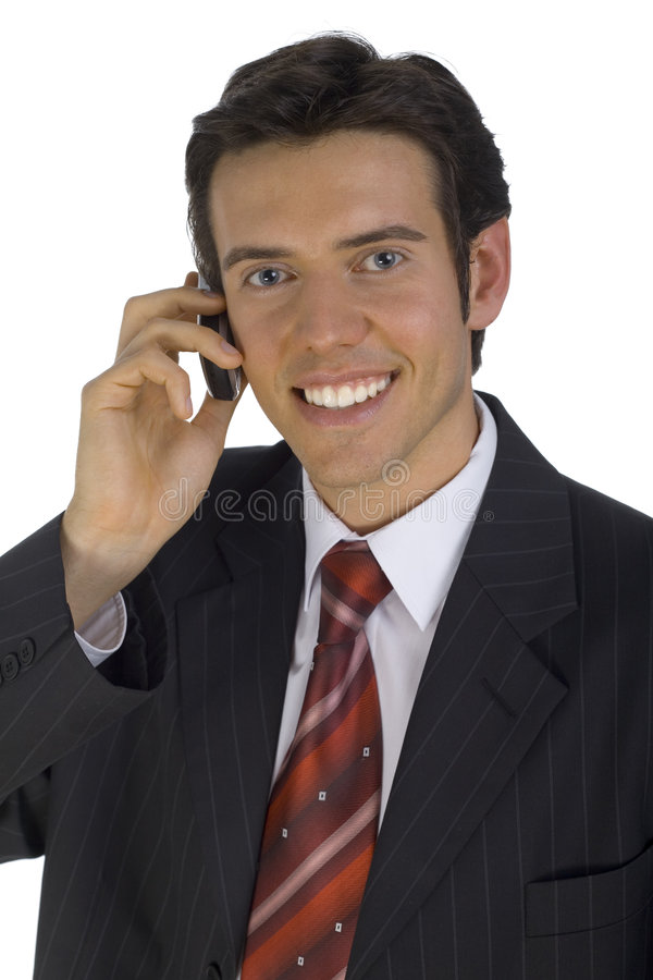 Young businessman. Smiling, handsome businessman. Talking by mobile phone. Looking at camera. Isolated on white in studio royalty free stock images
