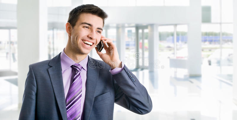Young businessman. Phoning in his office royalty free stock images