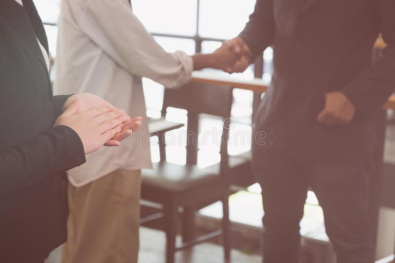 young businessman applauding to speaker after seminar presentation. business partners clapping hands after work meeting. royalty free stock photography