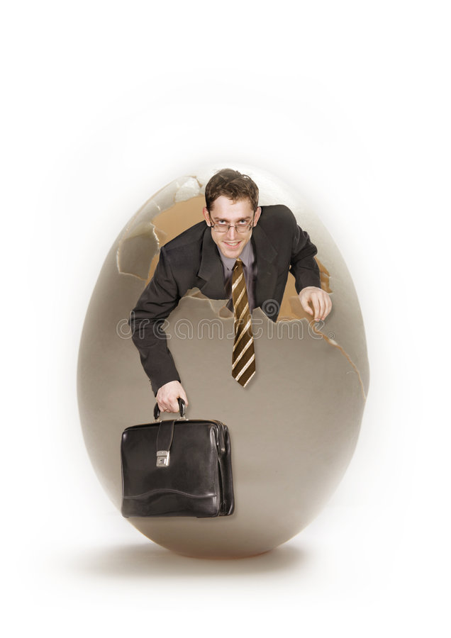 Young businessman and big egg royalty free stock photography