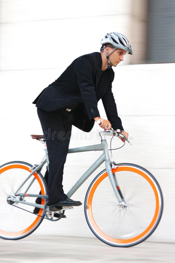 Young businessman biking to work