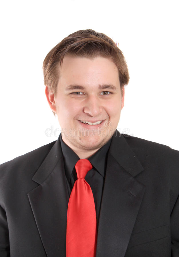 Young businessman in black suit smiling stock image