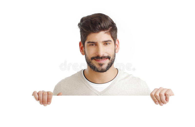 Young businessman with blank signboard stock image