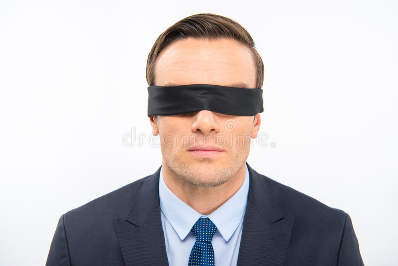 Young businessman in blindfold royalty free stock photos
