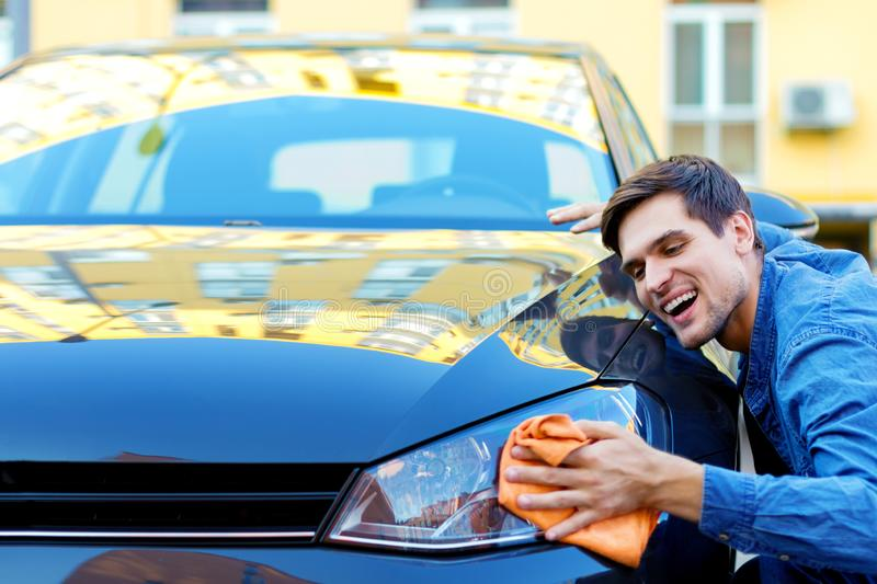 Young businessman bought new car stock photo