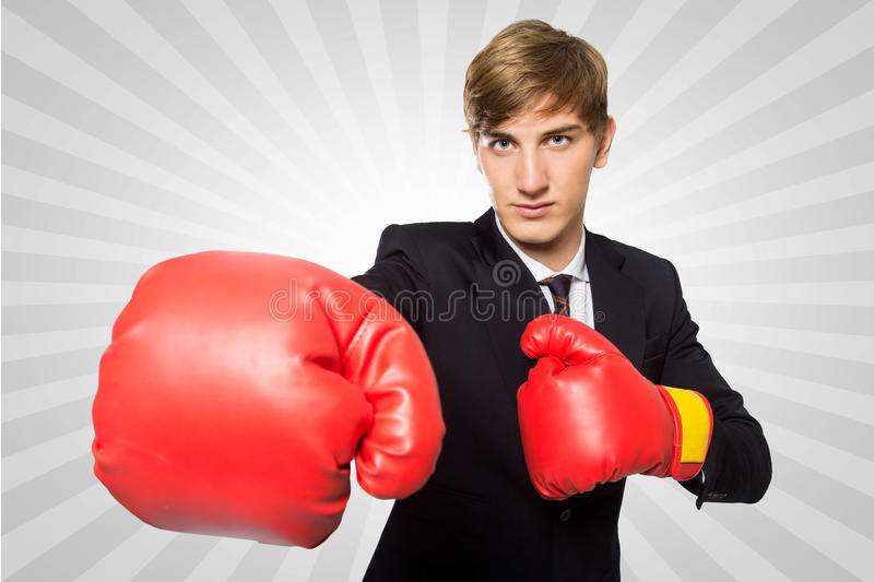 Young businessman with a boxing gloves concept, isolated stock image