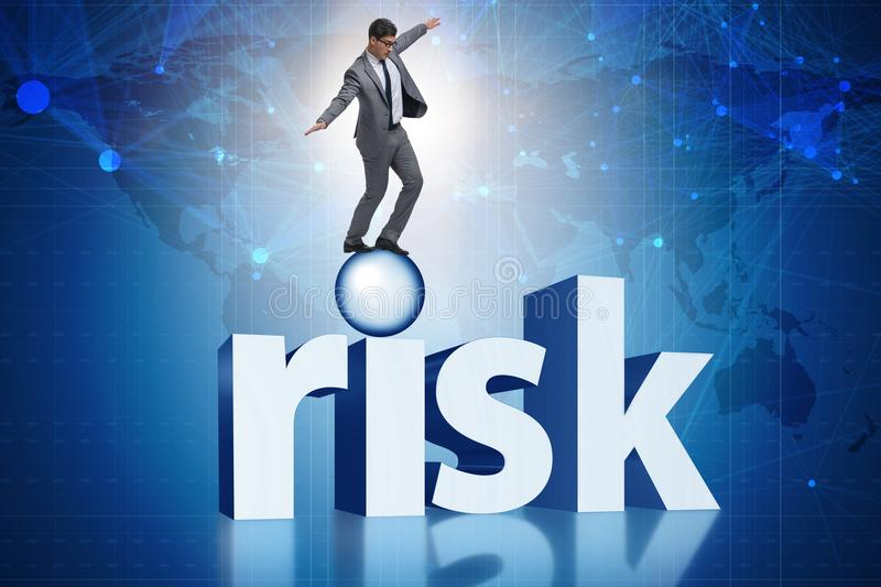 The young businessman in business risk and uncertainty concept. Young businessman in business risk and uncertainty concept royalty free stock photos