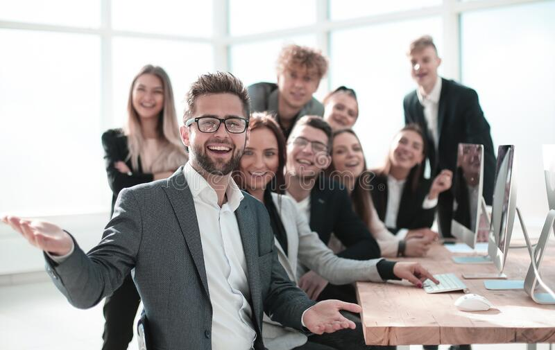 Young businessman and business team in the workplace. stock images