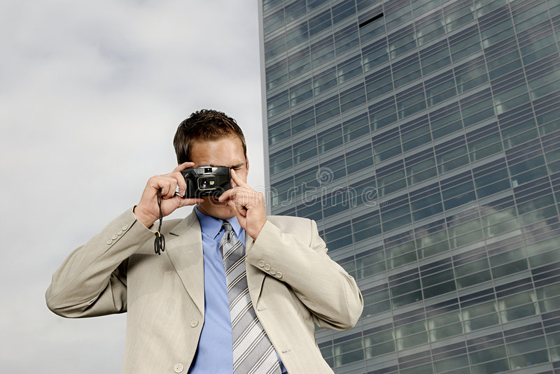 Young businessman with camera royalty free stock images