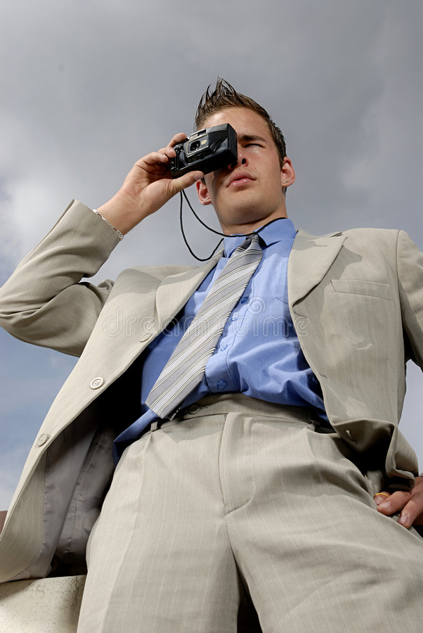 Young businessman with camera stock photos