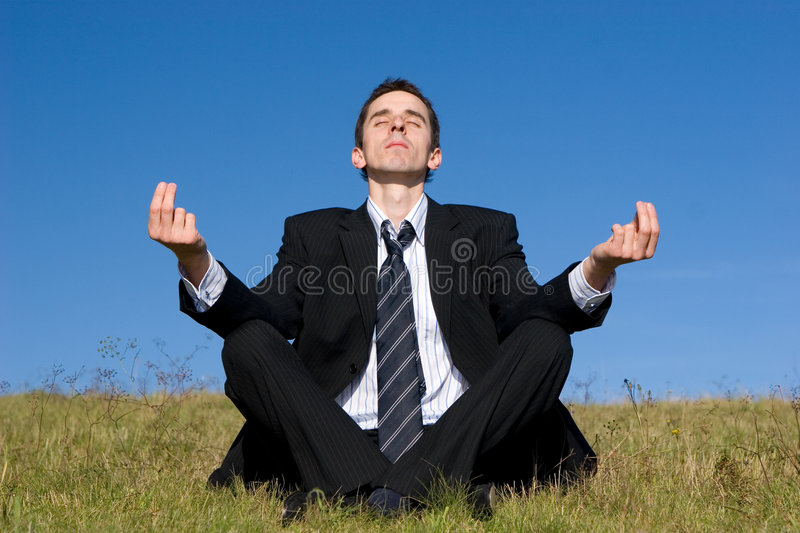 Young businessman catching the balance stock photo
