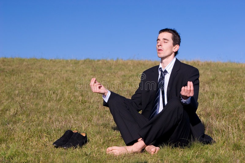 Young businessman catching the balance stock images