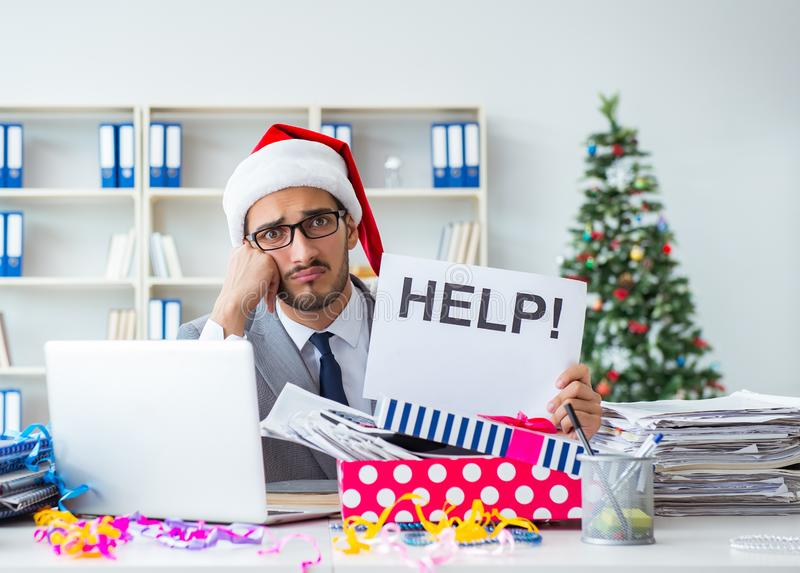 Young businessman celebrating christmas in the office stock photo